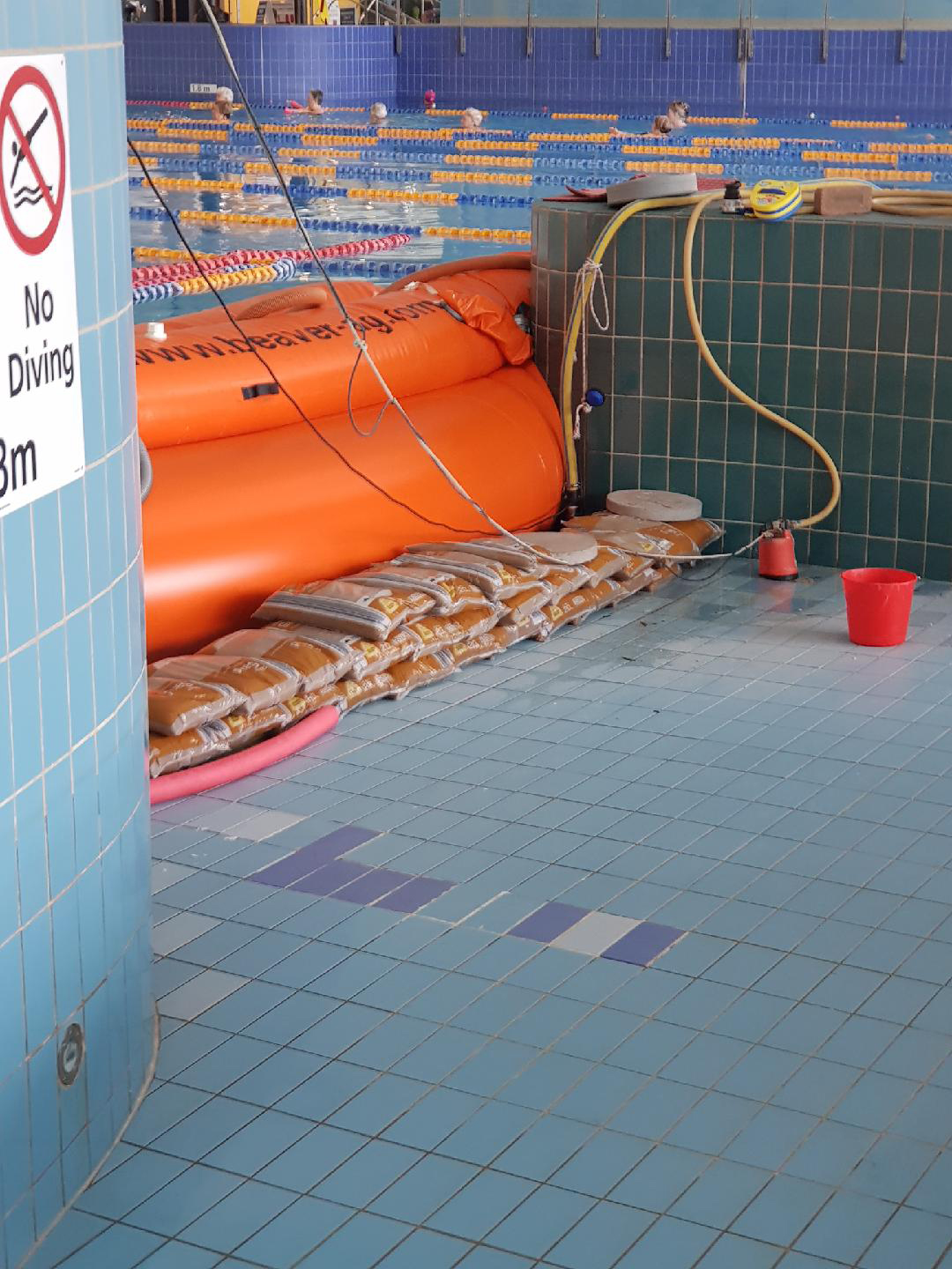 Public Pool Stays Open During Repairs Using A Water Dam