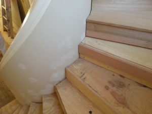 Carpenters Install new timber stairs